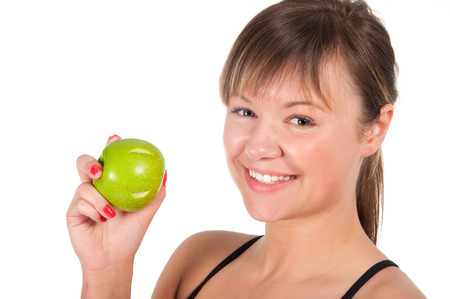 beautiful young sport  woman with green apple, isolated on white. photo