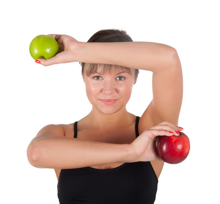 beautiful young sport  woman with red and green apple, isolated on white. photo