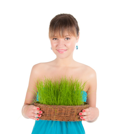 beautiful woman holding easter basket with green grass. symbol of nature photo