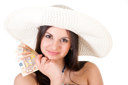 beautiful woman in summer dress with hat and money over white background photo