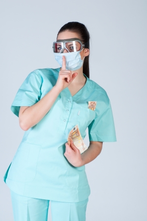 Nurse or doctor in pilot glasses with mask and money over gray background. corruption concept. Stock Photo - 23975988