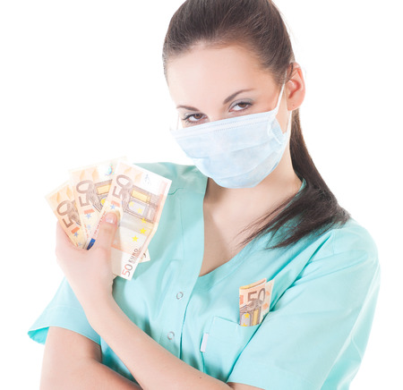 Female surgeon doctor holding money , isolated on white background photo