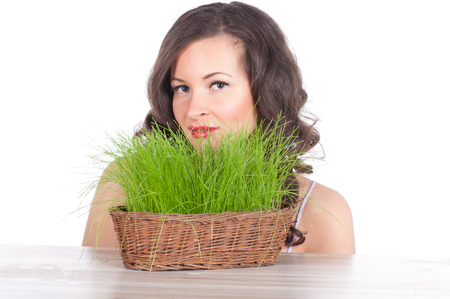 beautiful woman with easter basket with green grass. symbol of nature photo