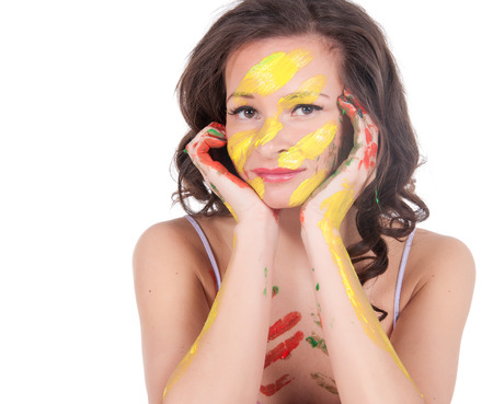 Happy young woman painting herself. Stock Photo - 23976191