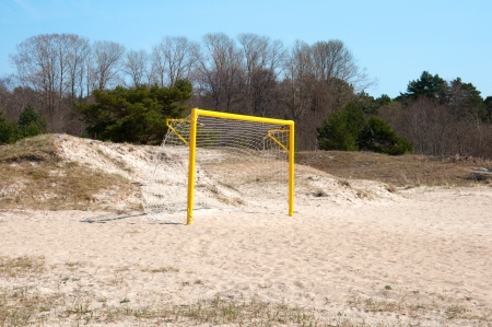 Football gate on a sand beach. summer sport time photo