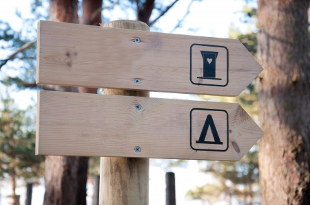 WC sign in the forest. photo
