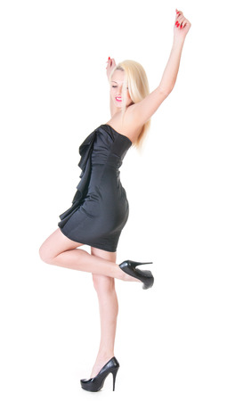 Sexy blond lady in black dress against white. photo