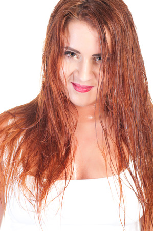 Sexy red hair woman in wet white t shirt. photo