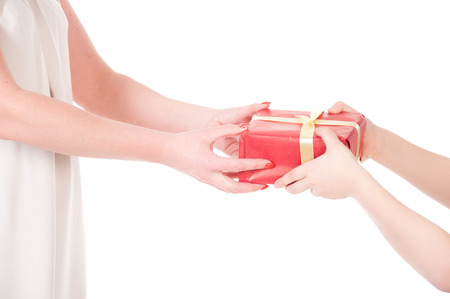 To hand a gift isolated on white. photo