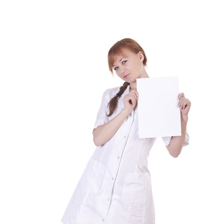 Young woman doctor is holding blank paper photo