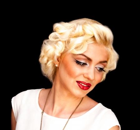 monroe: Pretty blond girl model like Marilyn Monroe in white dress with red lips on black background