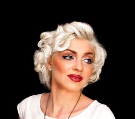 Pretty blond girl model like Marilyn Monroe in white dress with red lips on black background photo