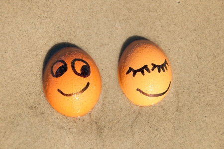 easter funny eggs  on a beach. photo