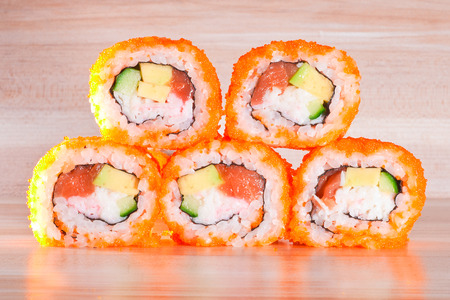 Maki Sushi roll a  on wooden background. photo