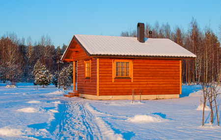 saun: wooden saun house in snow and frozen landscape. russian winter