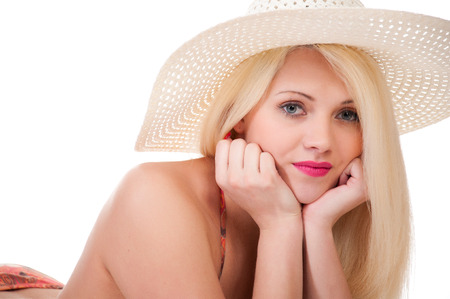 Beautiful young woman in hat and  bikini posing. over white background photo