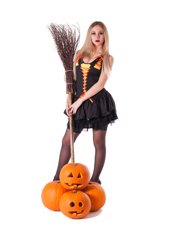 Halloween witch in black dress with pumpkin, broom.Isolated.