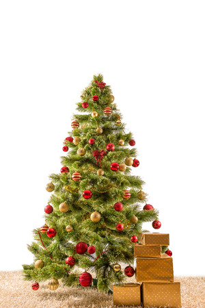 Decorated Christmas tree on a carpet with gifts  , card template