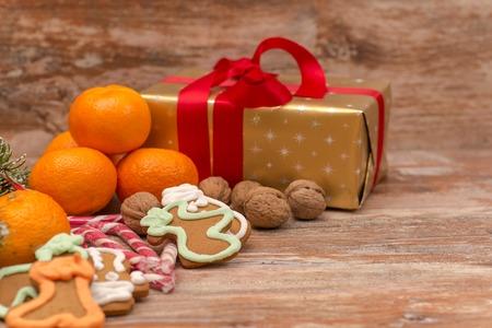 sweeties: Mandarines, gift box and sweeties, Christmas mood Stock Photo