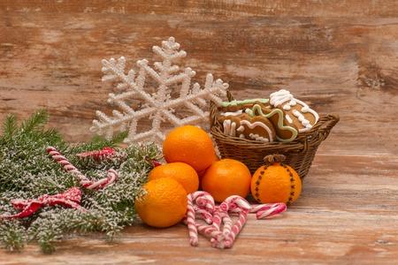 sweeties: Mandarines, gift box and sweeties, Christmas mood over wooden background