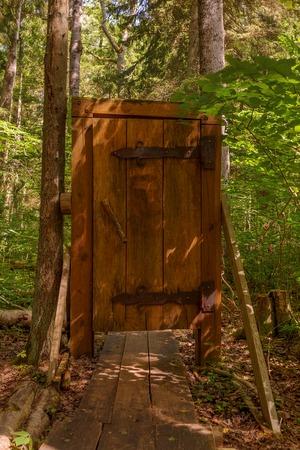 Wooden door on a walk way through the forest Stock fotó - 85310848