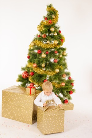 Little boy opening giftbox Stock Photo