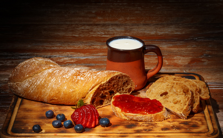 homemade breakfast with jam, milk and bread Stock Photo