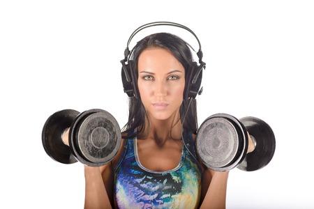 Fit femme saine avec des haltères et des écouteurs Banque d'images - 90020976