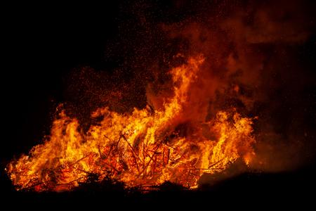 Bonfire burning trees at night. . Fire on black. Brightly, heat, light, camping, big bonfire