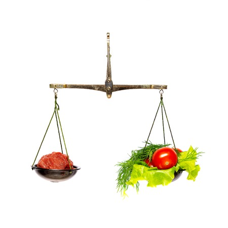 Healthy food and unhealthy food on scales.Dieting concept.Isolated.
