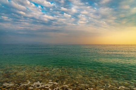 Ialisos stone beach and sea on sunset time