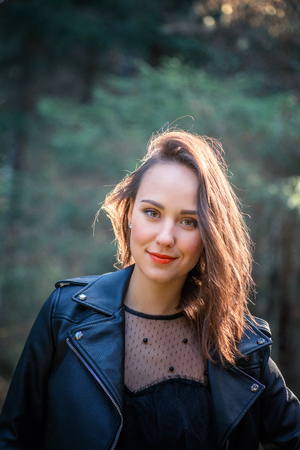 Outdoor fashion photo of young beautiful lady in a birch forest. 版權商用圖片