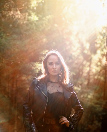 Outdoor fashion photo of young beautiful lady in a birch forest. Stock Photo