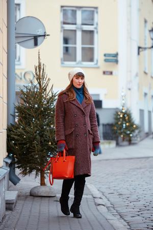 Portrait of beautiful girl walking on street in old town Tallinn