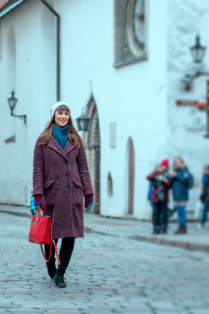 Portrait of beautiful girl walking on street in old town Tallinn