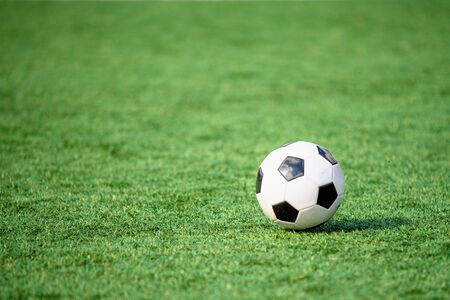 Soccer ball or football ball on green field 版權商用圖片