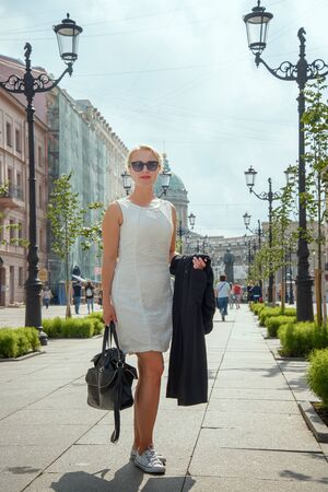 A woman walks through the center of St. Petersburg. Russia