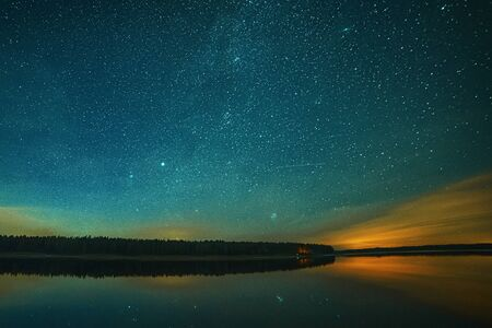 Peaceful starry night sky on the river landscape background Estonia