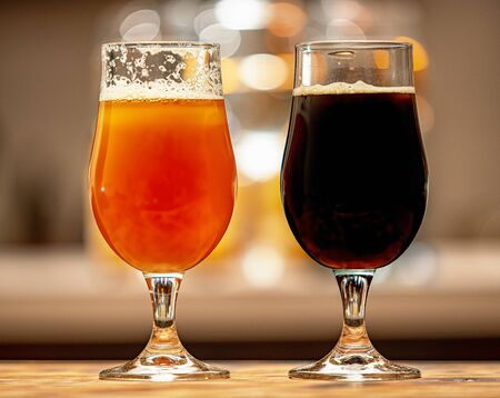 black and golden beer in glasses homemade brewing
