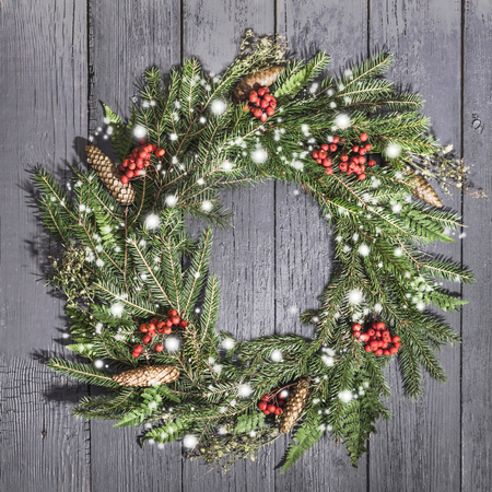 Christmas wreath of fir on a wooden background