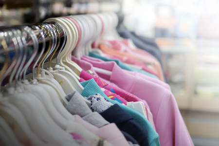 clothes hanging on a hanger in a store Stock Photo - 88711131