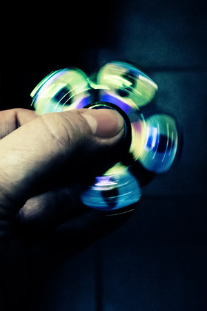 The hand rotates the color spinner very quickly. Freeze the movement.