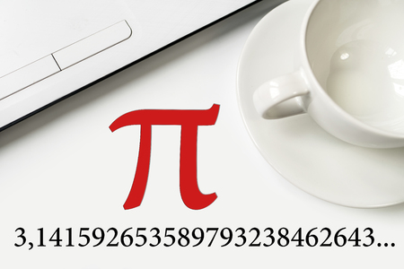 International Pi Day. On a white table a laptop and a cup. Large text and numbers.