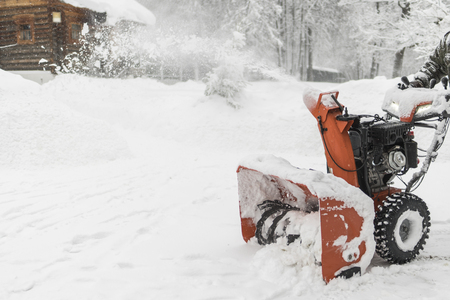 the worker removes the snow with a plow. Landscape in winter, Russia Stock Photo