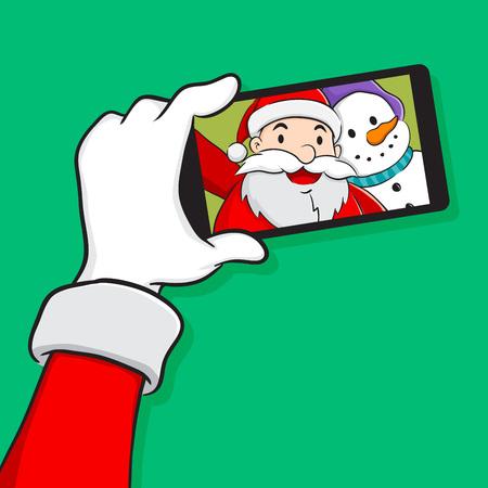 bonhomme de neige: P�re No�l et bonhomme de neige tenant selfie l'aide d'un t�l�phone intelligent
