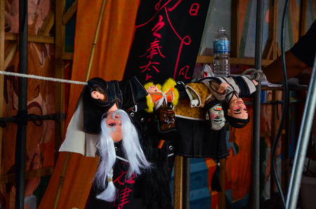 Taipei, Taiwan - NOV 05, 2017: Glove puppetry stage in Taiwan Traditional Theatre Center.a type of opera using cloth puppets that originated during the 17th century in China. Foto de archivo - 102968733
