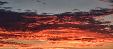 Coral orange sunset clouds for background.