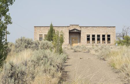 Old abandoned stone construction built schoolhouse in Fort Bidwell, Modoc County, California, USA.