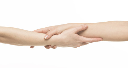 grasp: Two female hands holding on each other at the wrists, isolated on white