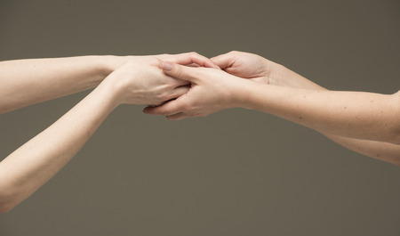entwined: Sensual female hands rubbing each other Stock Photo
